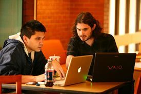Two students working on laptops