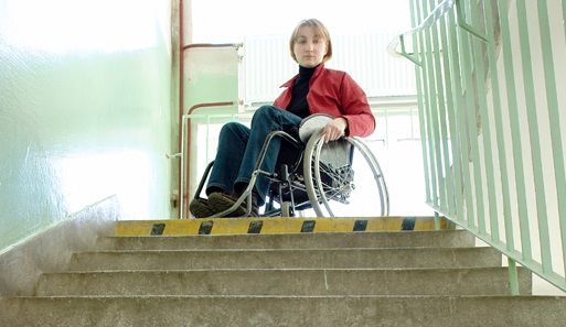 Person in a wheelchair looking down flight of stairs