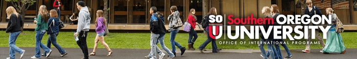 SOU students walking in front of the campus student union building.