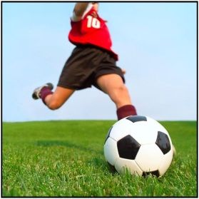 Photo of Child Kicking Soccer Ball