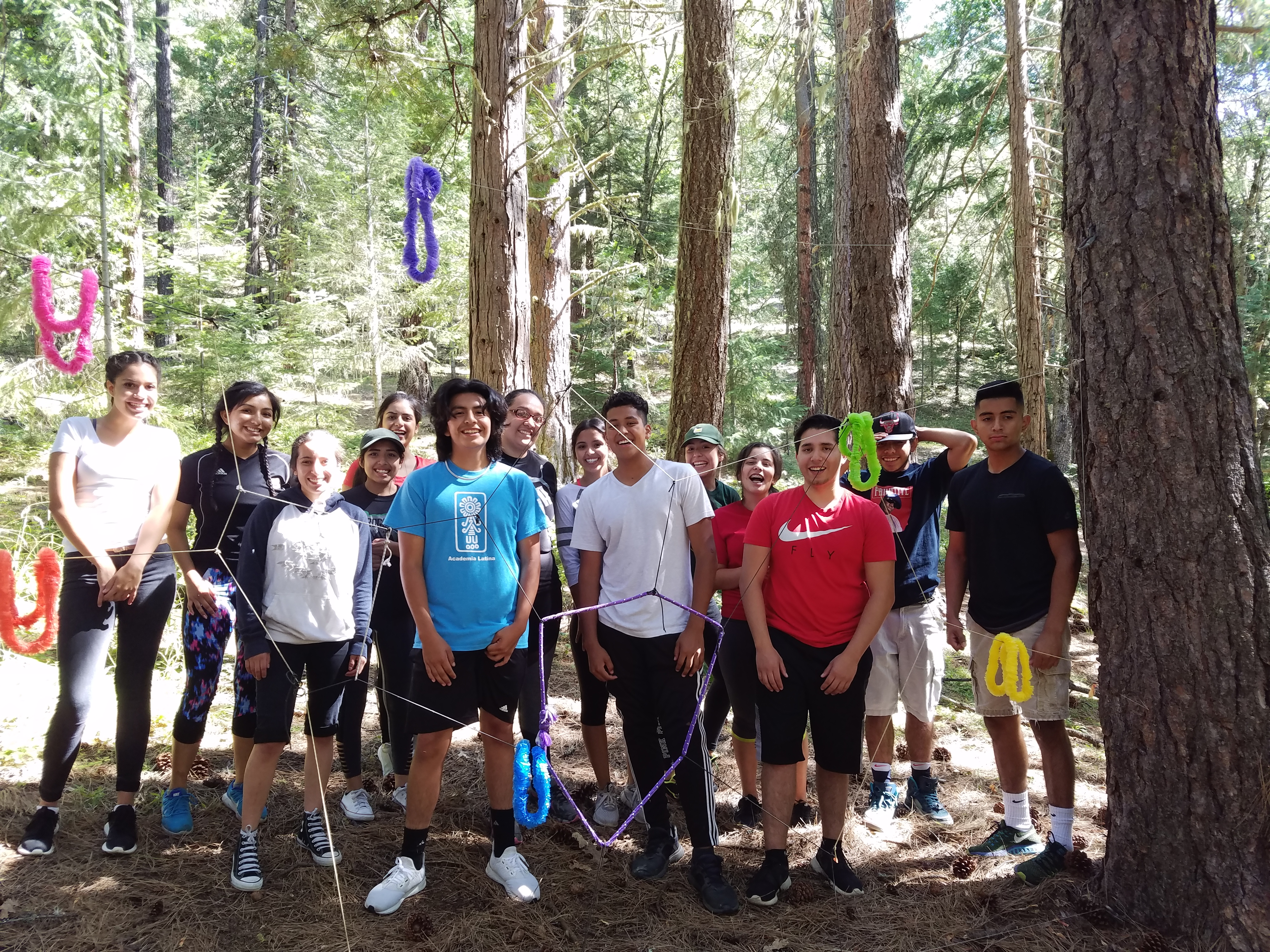 Leadership students outdoors with tall trees