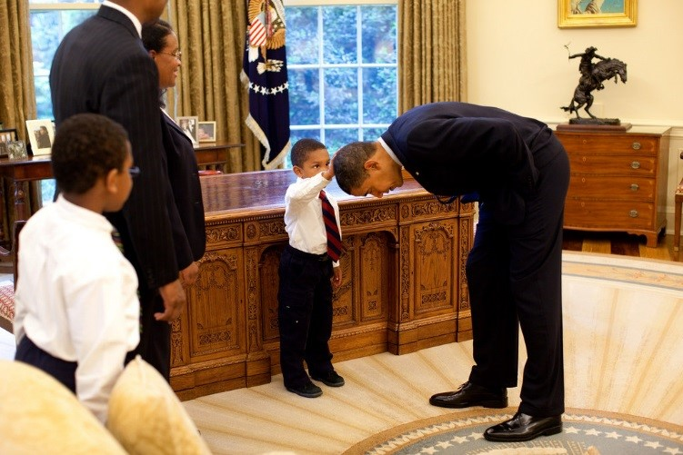 Boy touching Obama's hair
